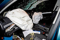 Deployed airbags and broken windscreen in a car after a road traffic accident..©shoutpictures.com..john@shoutpictures.com