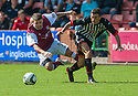 Arbroath's Bobby Linn is bundled over by Pars' Shaun Byrne.