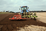 New Holland tractor disc harrowing field, Sutton, Suffolk, England