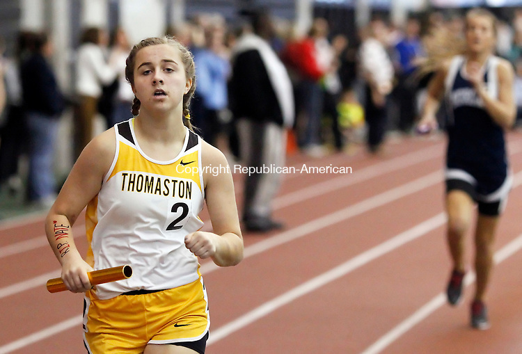 New Haven, CT-06 February 2012-021012CM06-   Thomaston's Sabrina Olsen races down the back stretch during the girls 4x800 relay at the Class S Track and Field Championships at the New Haven Athletic center Friday night in New Haven.  The relay took second in a time 9:48:58.  Christopher Massa Republican-American