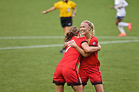 Portland, OR - Saturday, May 21, 2016: Portland Thorns FC midfielder Lindsey Horan (7) celebrates with Portland Thorns FC midfielder Dagny Brynjarsdottir (11). The Portland Thorns FC defeated the Washington Spirit 4-1 during a regular season National Women's Soccer League (NWSL) match at Providence Park.