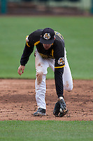 Erik Harbutz #38 of the Wichita State Shockers fields a ground ball during a game against the Missouri State Bears at Hammons Field on May 4, 2013 in Springfield, Missouri. (David Welker/Four Seam Images)
