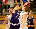 SIOUX FALLS, SD - DECEMBER 31: Tristan Teichmeier	 #33 from the University of Sioux Falls takes the ball to the basket between Marcus Asmus #30 and Bodey Behrends #32 from Augustana University during their game Sunday afternoon December 31, 2017 at the Stewart Center in Sioux Falls, SD.  (Photo by Dave Eggen/Inertia)