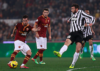 Calcio, quarti di finale di Coppa Italia: Roma vs Juventus. Roma, stadio Olimpico, 21 gennaio 2014.<br /> AS Roma midfielder Miralem Pjanic, of Bosnia, is challenged by Juventus defender Andrea Barzagli, right, as AS Roma forward Adem Ljajic, of Serbia, looks on during the Italian Cup round of eight final football match between AS Roma and Juventus, at Rome's Olympic stadium, 21 January 2014.<br /> UPDATE IMAGES PRESS/Isabella Bonotto