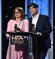 """BEVERLY HILLS - NOVEMBER 3: Kevin Feige and Victoria Alonso accept the Hollywood Blockbuster Award for """"Avengers: Endgame"""" onstage at the 2019 Hollywood Film Awards at the Beverly Hilton on November 3, 2019 in Beverly Hills, California. (Photo by Frank Micelotta/PictureGroup)"""