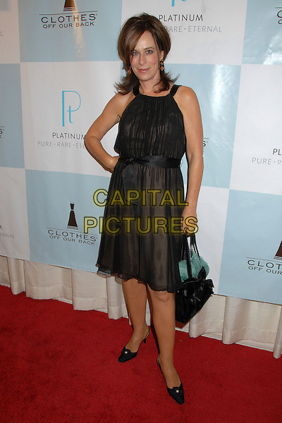 JANE KACZMAREK.Platinum Guild International and Clothes Off Our Back Celebration, Awards and Cocktail Party at the Luxe Hotel Rodeo Drive, Beverly Hills, California, USA..September 12th, 2007.full length black dress sash belt waist ribbon bag purse hand on hip .CAP/ADM/BP.©Byron Purvis/AdMedia/Capital Pictures.