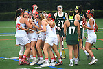 TAMPA, FL - MAY 20: Teammates congratulate Meghan O'Briend #25 of the Florida Southern Mocs after a goal against the Le Moyne Dolphins during the Division II Women's Lacrosse Championship held at the Naimoli Family Athletic and Intramural Complex on the University of Tampa campus on May 20, 2018 in Tampa, Florida. Le Moyne defeated Florida Southern 16-11 for the national title. (Photo by Jamie Schwaberow/NCAA Photos via Getty Images)