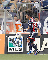 New England Revolution midfielder Lee Nguyen (24) collects a pass. In a Major League Soccer (MLS) match, Montreal Impact defeated the New England Revolution, 1-0, at Gillette Stadium on August 12, 2012.