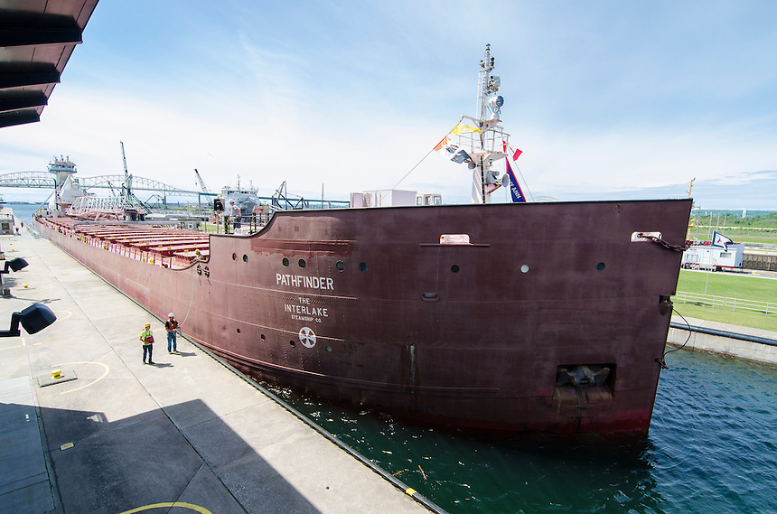 A scene at the impressive Soo Locks which connects Lake Superior to the St. Marys River Waterway. Sault Ste. Marie, MI