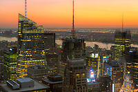 View looking southwest at twilight from the Top of the Rock including the Bank of America Tower, Conde Nast Building, and other Manhattan skyscrapers.  New Jersey can be seen on the other side of the Hudson River.