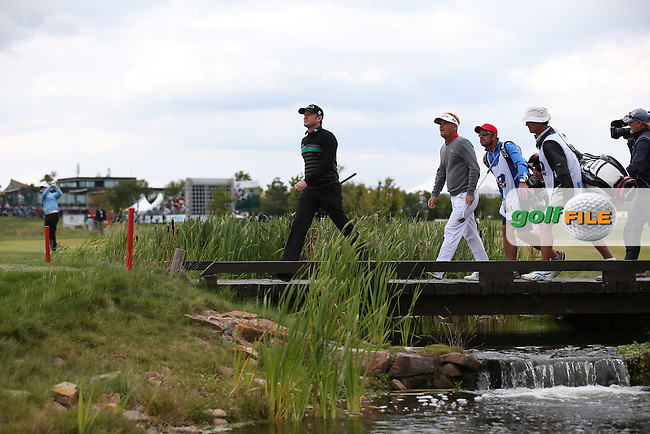 Jamie Donaldson (WAL) and Soren Kjeldsen (DEN) step over the 17th bridge during the Final Round of the D&D Real Czech Masters 2014 from the Albatross Golf Resort, Vysoky Ujezd, Prague. Picture:  David Lloyd / www.golffile.ie