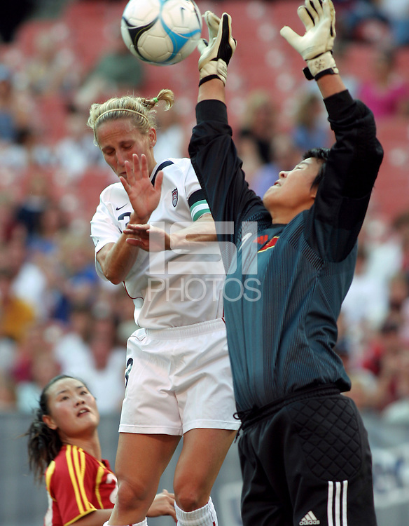 "Kristine Lilly vs Zhang Yanru.during the first of a six game ""Send Off Series"" between the US Women's National Team and China at Cleveland Browns Stadium in Cleveland, Ohio."