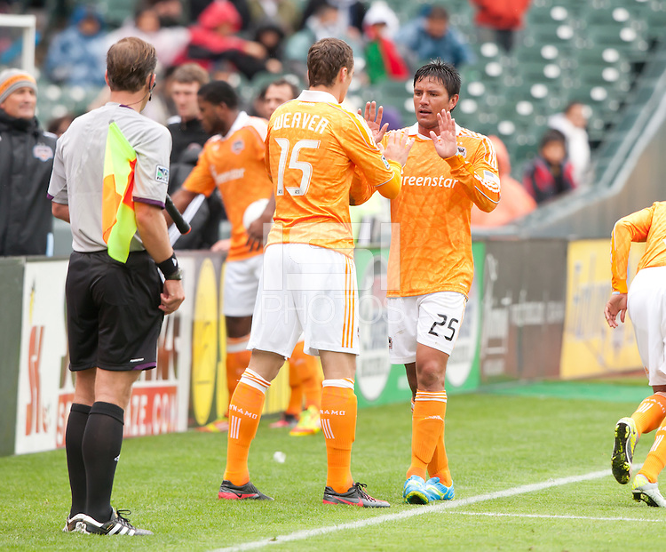 San Francisco, California - Saturday March 17, 2012: Brain Ching high fives Justin Morrow  during the MLS match at AT&T Park. Houston Dynamo defeated San Jose Earthquakes  1-0