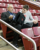 Mike Geragosian (BU - Assistant Coach) talks to Kieran Millan (BU - 31) before the game. - The Boston College Eagles defeated the visiting Boston University Terriers 5-2 on Saturday, December 4, 2010, at Conte Forum in Chestnut Hill, Massachusetts.