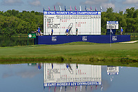Early first round scoring reflects off the lake near the green on 18 during round 1 of the 2018 KPMG Women's PGA Championship, Kemper Lakes Golf Club, at Kildeer, Illinois, USA. 6/28/2018.<br /> Picture: Golffile | Ken Murray<br /> <br /> All photo usage must carry mandatory copyright credit (&copy; Golffile | Ken Murray)
