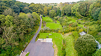 BNPS.co.uk (01202 558833)<br /> Pic: Savills/BNPS<br /> <br /> A secluded seaside home that is in arguably the most envious location in Britain has gone on the market for £2.5m.<br /> <br /> Waterwynch House sits by itself on the edge of a sea cove in the pretty Welsh coastal resort of Tenby.<br /> <br /> The large property leads directly onto an idyllic sandy beach that is private at high tide but can be accessed by the public when the water is out.<br /> <br /> Waterwynch is positioned in a valley beneath two cliffs and is set within 30 acres of grounds.