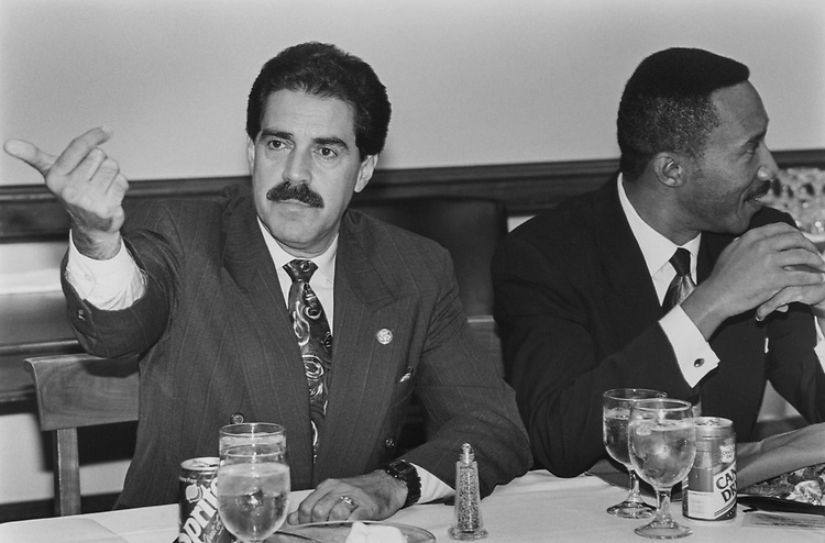 Rep. Jose E. Serrano, D-N.Y., and Rep. Kweisi Mfume, D-M.d., when the Hispanic Cacus and Black Caucus meet for lunch and  eat fried chicken, peach lobster, pound cake, potato salad, and green beans in Rayburn on Oct. 14, 1993. (Photo by Laura Patterson/CQ Roll Call via Getty Images)