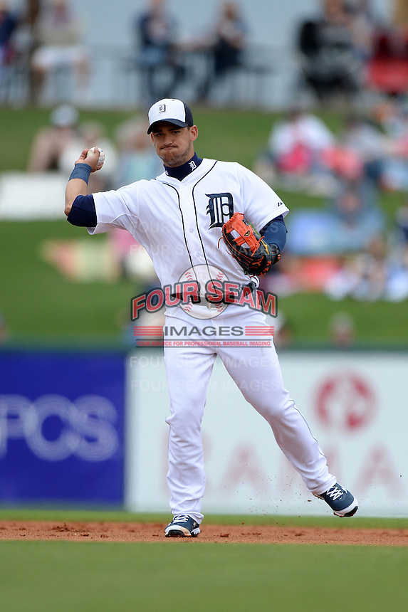 Detroit Tigers shortstop Jose Iglesias (1) during a spring training game against the Atlanta Braves on February 27, 2014 at Joker Marchant Stadium in Lakeland, Florida.  Detroit defeated Atlanta 5-2.  (Mike Janes/Four Seam Images)