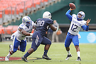 Washington, DC - September 16, 2016: Hampton Pirates quarterback Jaylian Williamson (12) passes the ball while being pressured by Howard Bison defensive lineman Myers Royce (90) during game between Hampton and Howard at  RFK Stadium in Washington, DC. September 16, 2016.  (Photo by Elliott Brown/Media Images International)