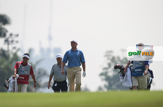 Team Europe's Jamie Donaldson (WAL) anxiously looks for his ball during the first day FourBall matches at the 2014 Eurasia Cup presented by DRB-Hicom, at the Glenmarie Golf & Country Club, Kuala Lumpur, Malaysia. Picture:  David Lloyd / www.golffile.ie