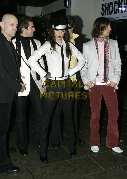 JULIETTE LEWIS & BAND.The Shockwaves NME Awards 2005,.Hammersmith Palais, Shepherds Bush Road,.London, February 17th 2005..full length white shirt black hat juliet tie.Ref: AH.www.capitalpictures.com.sales@capitalpictures.com.©Capital Pictures.