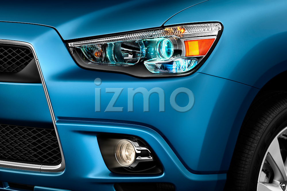 Headlight detail view of a 2012 Mitsubishi Outlander Sport
