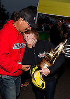 Aug 17, 2014; Brainerd, MN, USA; Charlotte Lucas , mother of NHRA top fuel dragster driver Morgan Lucas (not pictured) reacts after Morgan won the Lucas Oil Nationals at Brainerd International Raceway. Mandatory Credit: Mark J. Rebilas-