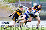 Colm Murphy Castleisland Desmonds is upended by David O'Leary and Mike Moloney Dr Crokes during their Div 1 clash in Killarney on Saturday evening