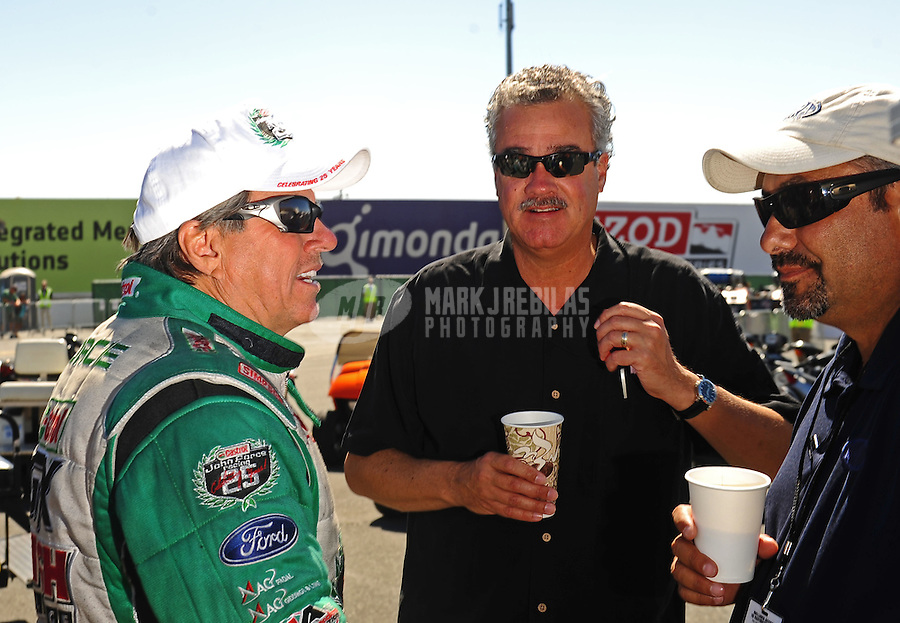 Jul. 18, 2010; Sonoma, CA, USA; NHRA funny car driver John Force (left) talks with NHRA president Tom Compton (center) and Jerry Archambeault during the Fram Autolite Nationals at Infineon Raceway. Mandatory Credit: Mark J. Rebilas-