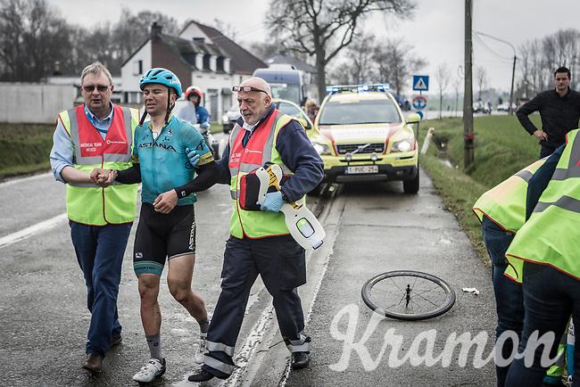 Alexey Lutsenko (KAZ/Astana) is escorted to the ambulance after a peloton crash.<br /> <br /> <br /> 102nd Ronde van Vlaanderen 2018 (1.UWT)<br /> Antwerpen - Oudenaarde (BEL): 265km