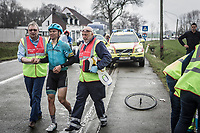 Alexey Lutsenko (KAZ/Astana) is escorted to the ambulance after a peloton crash.<br /> <br /> <br /> 102nd Ronde van Vlaanderen 2018 (1.UWT)<br /> Antwerpen - Oudenaarde (BEL): 265km