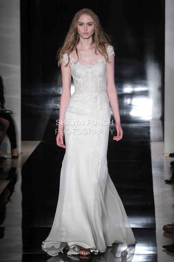 Model walks runway in a silk chiffon fit and flare gown with embroidered lace, from the Reem Acra Spring 2017 bridal collection, during New York Bridal Fashion Week Spring Summer 2017, on April 15, 2016.