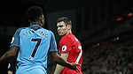 James Milner of Liverpool and Raheem Sterling of Manchester City argue during the English Premier League match at Anfield Stadium, Liverpool. Picture date: December 31st, 2016. Photo credit should read: Lynne Cameron/Sportimage