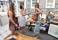 Nikki Schuerch, left, of Newtown and Brooke Conroy, right, of Philadelphia chat with Ashara Shapiro, center, of Reclaimed Design during Doylestown Arts Fest  September 10, 2016 in Doylestown, Pennsylvania. (Photo by William Thomas Cain)