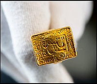 BNPS.co.uk (01202) 558833<br /> Pic: PhilYeomans/BNPS<br /> <br /> Major Thomas Hart's solid gold seal ring, used by the East India Company officer in lieu of cash payment for supplies. <br /> <br /> Stunning artefacts from Indian hero Tipu Sultan's fateful last stand have been rediscovered by the family of an East India Company Major who took part in the famous battle that ended his reign.<br /> <br /> And now Major Thomas Hart's lucky descendents are likely to become overnight millionaires after retrieving the historic items from their dusty attic.<br /> <br /> The fascinating treasures were taken from Tipu's captured fortress of Seringapatam in the wake of his defeat by British forces led by a young Duke of Wellington in 1799.<br /> <br /> The cache of ornate gold arms and personal effects even include's the battle damaged musket the Sultan used in his fatal last stand against the expanding British Empire in India.<br /> <br /> Tipu was last seen on the battlements of the fortress firing his hunting musket at the advancing British and after the fierce encounter his body was found bearing many wounds, including a musket ball shot above his right eye.<br /> <br /> The rediscovered musket, complete with battle damaged bayonet, has the distinctive tiger stripe pattern unique to the self styled Tiger of Mysore own weapons - and tellingly there is also shot damage to the lock and stock that may have been caused by the musket ball that finished him off.<br /> <br /> Also included in the sale are four ornate gold-encrusted sword's bearing the mark of Haider Ali Khan, Tipu's father and the previous ruler of independent Mysore, along with a solid gold &lsquo;betel casket&rsquo; complete with three 220 year old nuts still inside.<br /> <br /> The war booty was brought back to Britain by Major Thomas Hart of the British East India Company following the fourth and final Anglo-Mysore war.<br /> <br /> They have been passed down through the family ever since and now belong to a couple who have kept them wrapped in newspaper in the dusty attic of their semi-detached home for years.