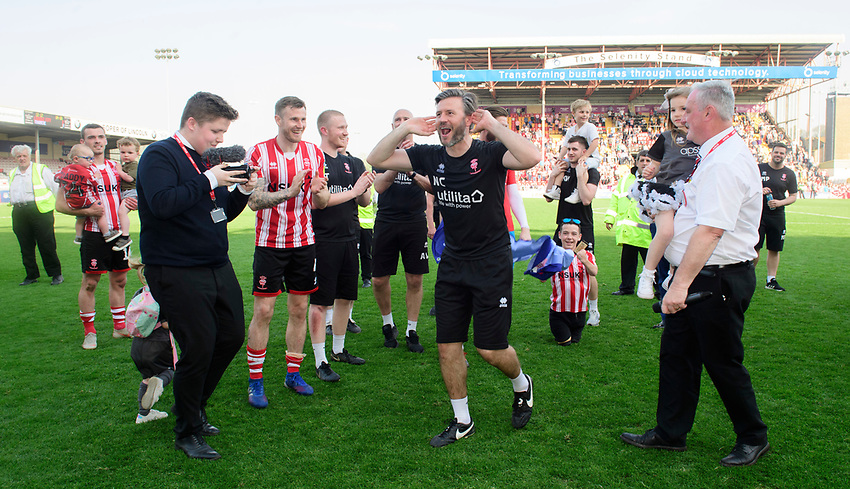 Lincoln City's assistant manager Nicky Cowley celebrates after winning the league<br /> <br /> Photographer Chris Vaughan/CameraSport<br /> <br /> The EFL Sky Bet League Two - Lincoln City v Tranmere Rovers - Monday 22nd April 2019 - Sincil Bank - Lincoln<br /> <br /> World Copyright © 2019 CameraSport. All rights reserved. 43 Linden Ave. Countesthorpe. Leicester. England. LE8 5PG - Tel: +44 (0) 116 277 4147 - admin@camerasport.com - www.camerasport.com