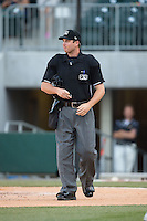 Home plate umpire Matt McCoy between innings of the International League game between the Indianapolis Indians and the Charlotte Knights at BB&T BallPark on June 20, 2015 in Charlotte, North Carolina.  The Knights defeated the Indians 6-5 in 12 innings.  (Brian Westerholt/Four Seam Images)