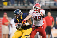 October 22th, 2011:  Anthony Miller of California catches and controls the ball away from Trevor Reily of Utah for a first down during a game at AT&T Park in San Francisco, Ca  -  California Defeated Utah 34 - 10