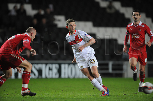 20.03.2012 Milton Keynes, England. Milton Keynes Dons v Leyton Orient.  James O'Shea (MK Dons) Midfielder  in action during the NPower League 1 game played at Stadium MK.