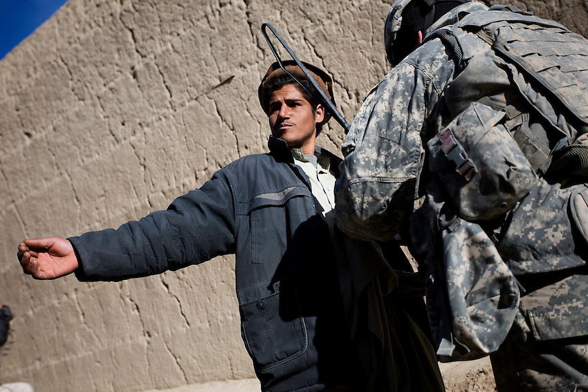 A member of 1/506th Infantry, Scout Platoon, searches an Afghan man during an operation in Shamamolzi, Paktika province, Afghanistan, Sunday, Feb. 8, 2009.