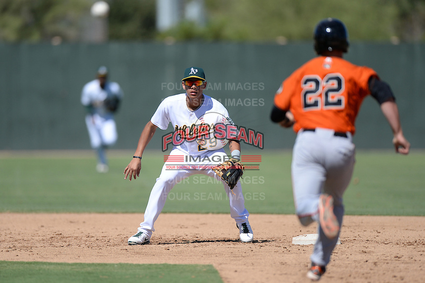 Oakland Athletics infielder Edwin Diaz (29) waits for the throw as Christian Arroyo (22) heads to second during an instructional league game against the San Francisco Giants on September 27, 2013 at Papago Park Baseball Complex in Phoenix, Arizona.  (Mike Janes/Four Seam Images)