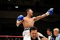 (T-B) Akira Yaegashi (JPN), Koji Matsumoto, OCTOBER 24, 2011 - Boxing : Akira Yaegashi of Japan celebrates with his trainer Koji Matsumoto after winning the WBA minimumweight title bout at Korakuen Hall in Tokyo, Japan. (Photo by Mikio Nakai/AFLO)