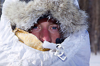 Saturday March 10, 2012  Nicholas Petit all bundled up into a tunnel in Galena Iditarod 2012.