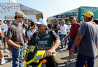 Sept. 22, 2012; Ennis, TX, USA: NHRA funny car driver John Force splits the crowd with his scooter during qualifying for the Fall Nationals at the Texas Motorplex. Mandatory Credit: Mark J. Rebilas-