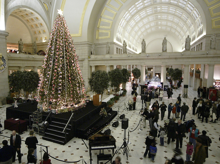 "The official tree lighting ceremony was held in Union Station last night at 6:00 p.m. The festivities of a Norwegian Christmas at Union Station in Washington D.C. included a speeches and a choir signing Christmas carols. CREDIT MUST READ: ""ALEX LORMAN/NORWEGIAN EMBASSY"""