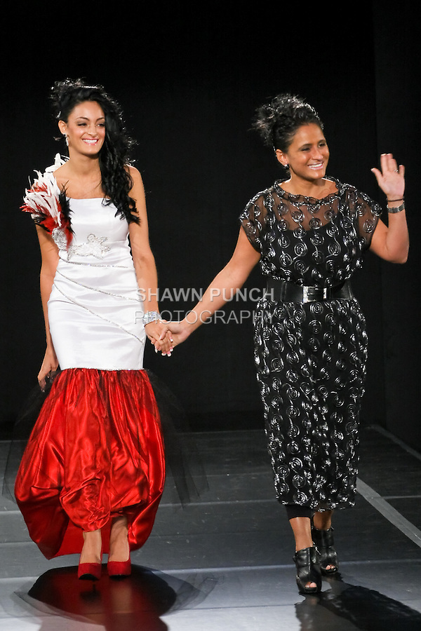 Simone Rodrigues walks the runway with model at the close of the Sisa Fashion Designs Spring 2011 fashion runway show, during Couture Fashion Week, September 11, 2010.