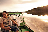 BRAZIL,  Amazon Jungle, fly fishing guide racing back to the lodge at the end of the day, Agua Boa fishing lodge