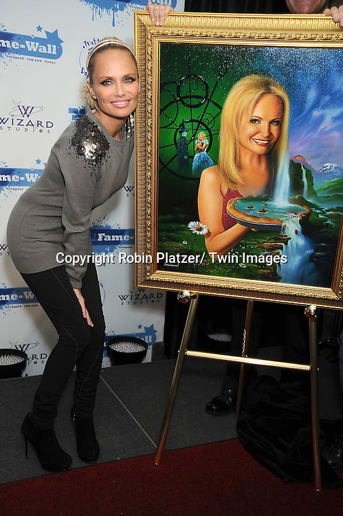 Kristin Chenoweth and her portrait  at the unveiling of portraits of Sean Hayes and Kristin Chenoweth by Jim Warren, the artist, at Trattoria Dopo Teatro in New York City on November 21, 2010.