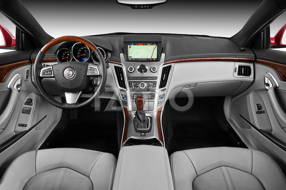 Straight dashboard view of a 2011 Cadillac CTS Coupe Premium.