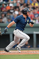 Left fielder Tim Tebow (15) of the Columbia Fireflies runs out a batted ball in a game against the Greenville Drive on Tuesday, June 13, 2017, at Fluor Field at the West End in Greenville, South Carolina. Greenville won, 5-4. (Tom Priddy/Four Seam Images)